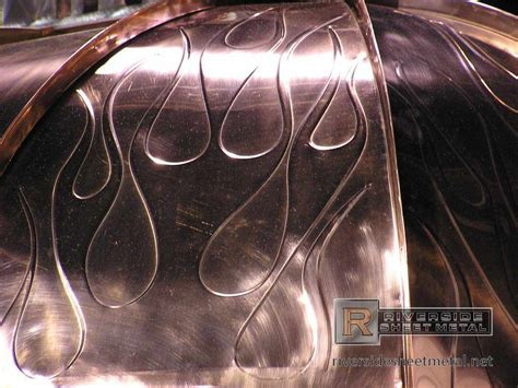 Radius copper panels with flame details   Metal Roof Panels