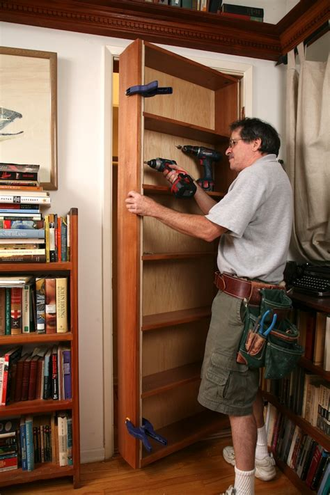 building a secret door pivot bookcase installation thisiscarpentry
