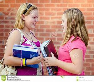 Two Adolescent Girls Talking Outside School Royalty Free ...