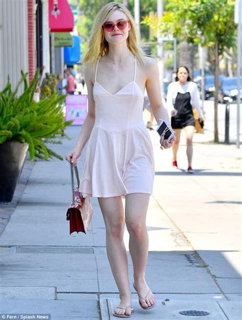 Elle Fanning flashes porcelain skin in skimpy mini-dress ...