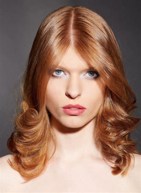 shoulder length strawberry blonde hair   center part