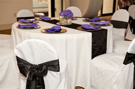 tables were covered with white linen tablecloths and black