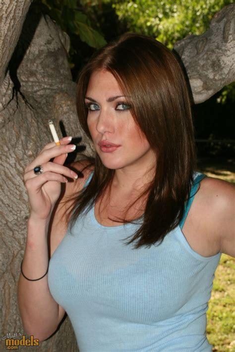 Busty Victoria Vonn stripping outdoors