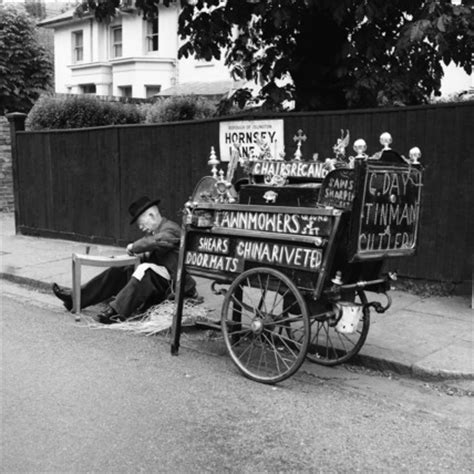 tradesman with his street cart recaning a chair 1956 by