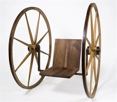 made wagon wheel chair by wumato design studios