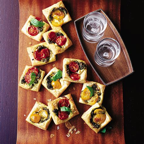 puff pastry canapes ideas pastry squares with goat 39 s cheese pesto and tomato delicious magazine