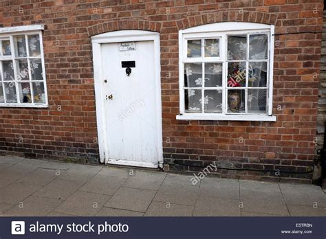 brick wall in house old white door and window in brick wall house stock photo royalty free image 72459961 alamy