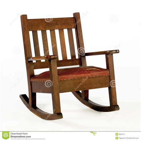 oak rocking chair with leather cushion editorial photo