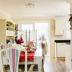Cream Dining Area With Nautical Theme  Dining Room