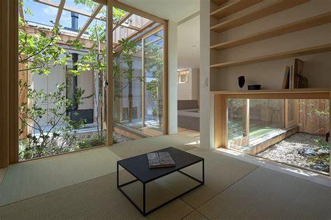 modern japanese house tucks in three courtyards