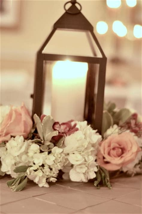 lantern with flowers centerpieces Southern Productions