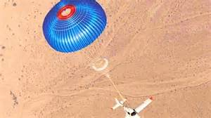Plane with parachute miraculously survives engine failure ...