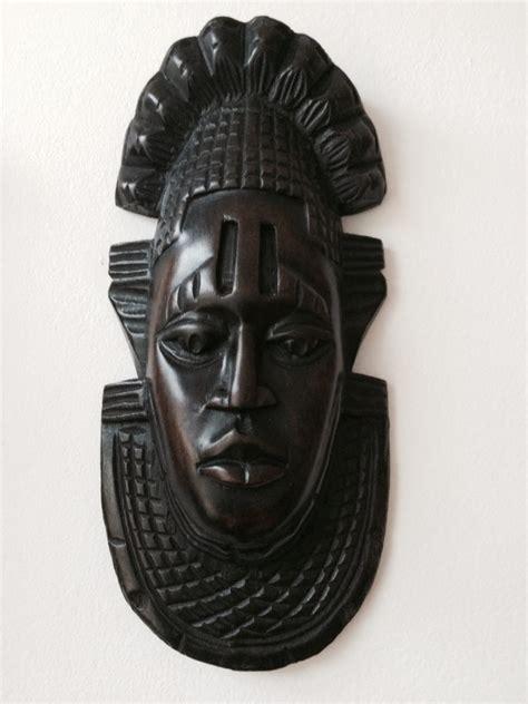 small black african wooden mask kazeem  tomb raider