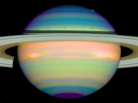 saturn color an infrared view of saturn esa hubble