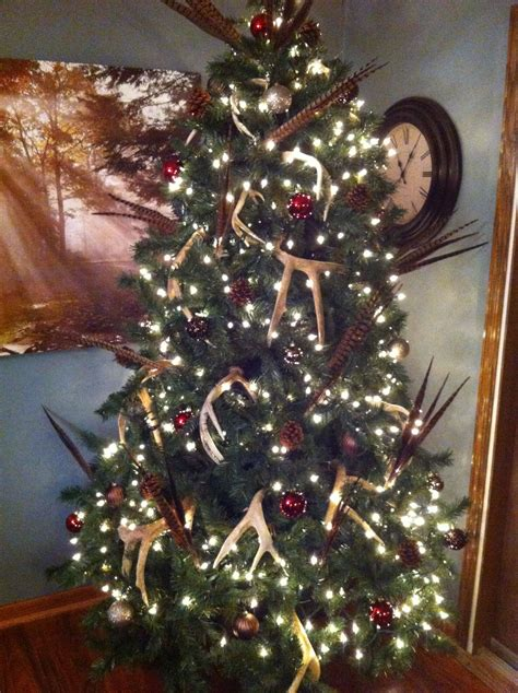 country christmas tree deer antlers pheasant feathers