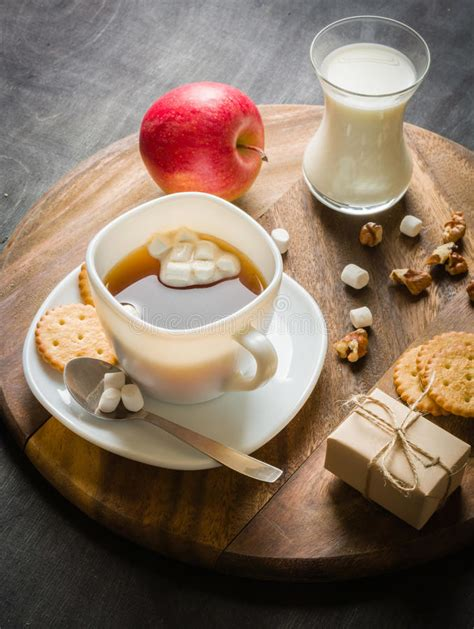 One morning, some time ago, i was having breakfast on a black sheet that i normally use for work. Morning Coffee With Marshmallows, Cookies And Milk. Dark Wooden Background. Stock Photo - Image ...