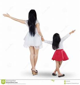 Back View Of Mother And Daughter Holding Hands Stock Image ...