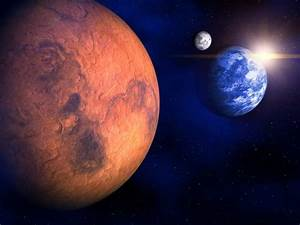Much of ancient Martian atmosphere frozen at poles ...