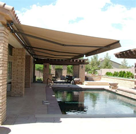 Backyard Awning by Custom Retractable Awning Paradise Outdoor Kitchens
