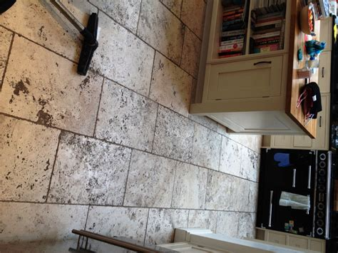 deep cleaning dirty tumbled travertine kitchen tiles in