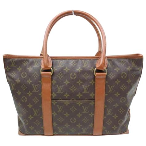 louis vuitton pre owned cloth tote  brown lyst
