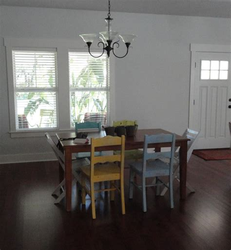 different colored chairs in dining room