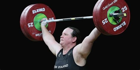 biological male weightlifter competing  female wins
