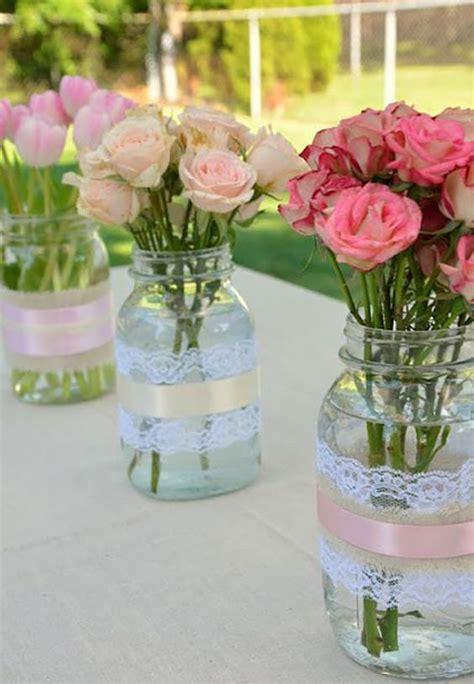 5 centros de mesa con frascos de vidrio