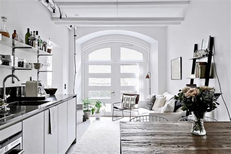 chic studio apartment divides space  glass partition