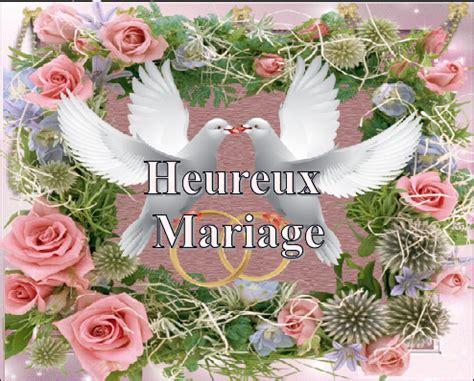 heureux mariage roses et 2 colombes avec alliances