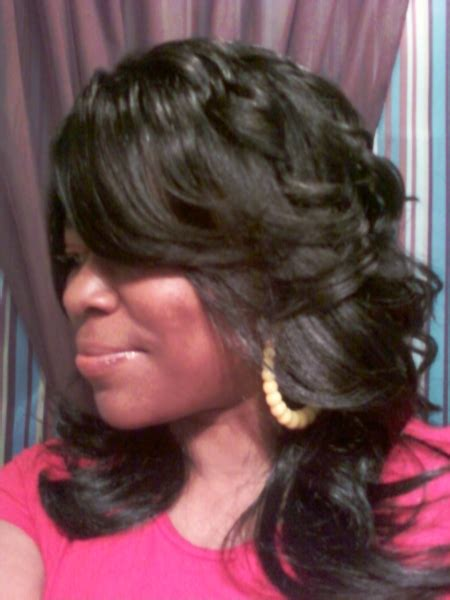Feathered Hairstyles For Black by Layered And Feathered Wig Hairstyle For Black
