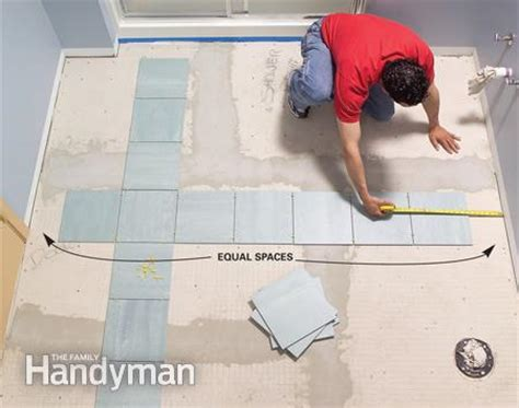 how to lay floor tiles install a ceramic tile floor in the bathroom the family handyman