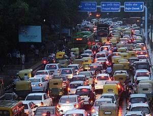 Chaos on Delhi roads as heavy rain causes massive traffic ...