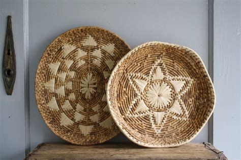 It is essential to determine the size, style, and the owner's tastes and artist preferences before shopping for the items on the site. vintage corn husk baskets woven wall decor