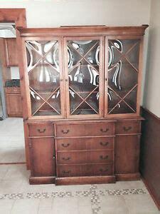 saginaw furniture breakfront  curved glass antique