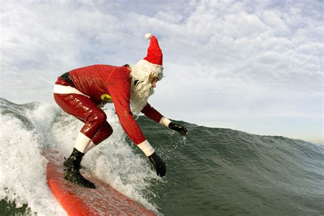 santa claus is a professional surfer