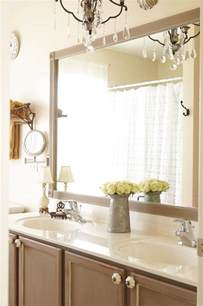 mirror in bathroom ideas diy bathroom mirror frame update white lace cottage 19491
