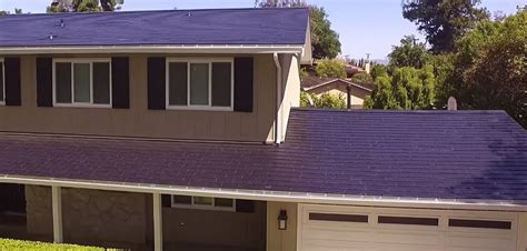 tesla solar roof tesla solar roof owner discusses installation price maintenance and savings