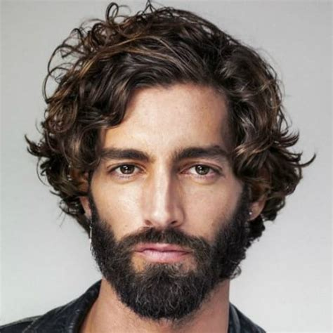 This hanging locks hairstyle is perfect for any man with long hair that wants to go just a little bit shorter. 60+ Curly Hairstyles for Men to Style those Curls - Men ...