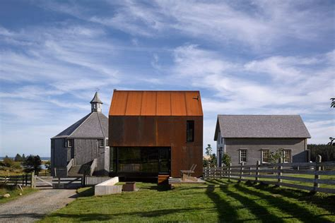 Weathered Steel Clad Cabin Joins Bucolic Compound In