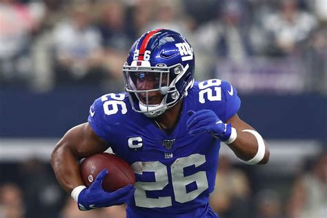 report giants rb saquon barkley suffers high ankle sprain