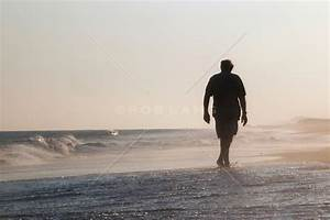 man in silhouette walking on the beach at sunset | ROB ...