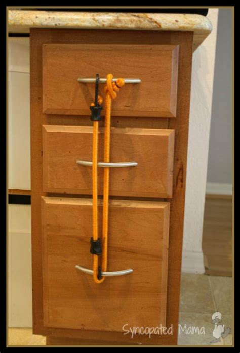 child proof locks for cabinets without handles 28 ways to use bungee cords in your home diy bungee cord