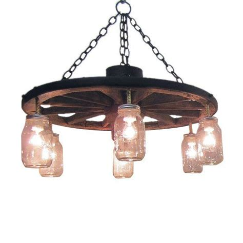 25 best ideas about wagon wheel chandelier on