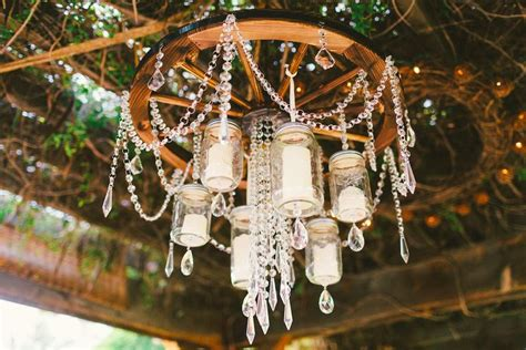 diy jar wagon wheel chandelier wedding day