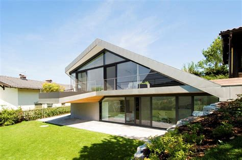 Slope Roof House With Futuristic Interiors  Modern House