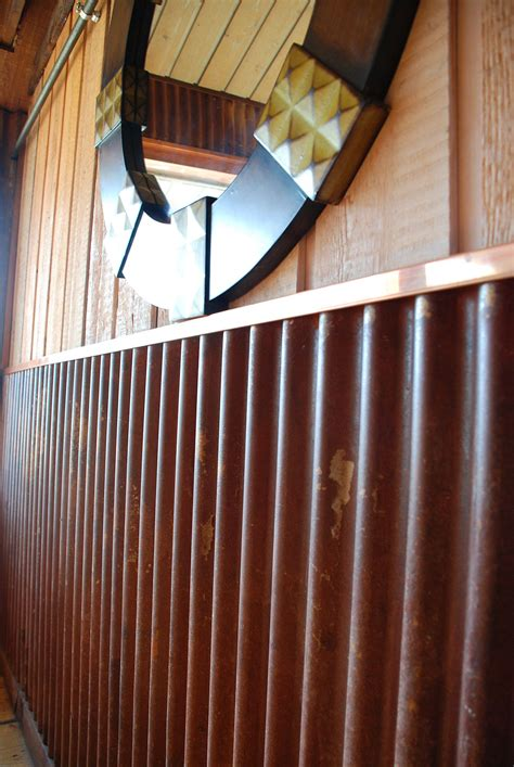 Tin Wainscoting Panels by Truten Corrugated With Copper Trim In Restaurant Comes