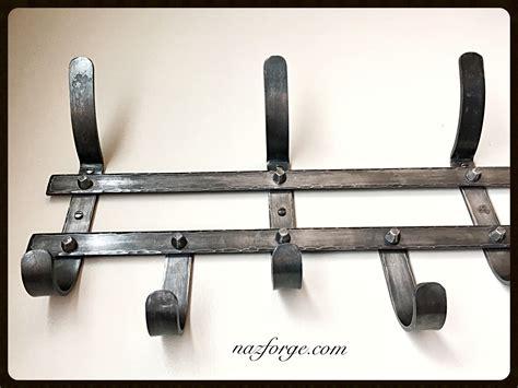 iron coat rack hand forged   blacksmith rustic hooks dark wax protection  naz forge
