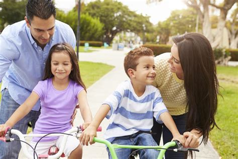 understanding the theory of observational learning with 740 | 1200 514134651 parent teaching children to ride bikes