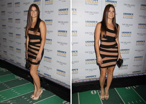 Danica Patrick   Mid back long hair, sectioned in the middle